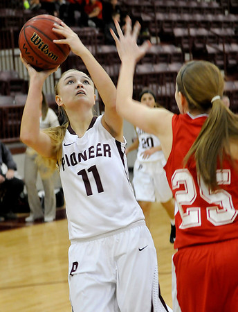 Pioneer's Lexsie Mann shoots over Dover's Emily Mathews Tuesday at Pioneer High School. (Staff Photo by BILLY HEFTON)