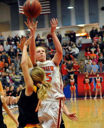 Fairview's Olivia Mason puts up a shot against Alva during the finals of the 44th annual Wheat Capital Basketball Tournament Saturday at Chisholm High School. (Staff Photo by BILLY HEFTON)
