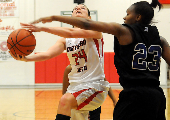 NOC-Enid's Christa Beasler draws a foul from Carl Albert's Kasuela Cooper Wednesday during the Lady Jets' 64-53 victory over the Lady Vikings at the Mabee Center. (Staff Photo by BONNIE VCULEK)