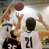 Pioneer's Brandon McNaughton dishes the ball to teammate Blake Gabriel during the Mustangs' 65-63 overtime win against the Crescent Tigers at Pioneer High School Friday, Jan. 03, 2014. (Staff Photo by BONNIE VCULEK)