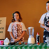 Camden and Caton Cope, from the Watonga 4-H, assemble PCIC Shakes during their 4-H demonstration competition at Oakwood Mall Saturday, Jan. 04, 2014. The shake, blended with 1.5 cups of vanilla ice cream, 1 cup milk, 1/3 cup chocolate syrup, 2 tablespoons peanut butter, and garnished with whipped topping and a cherry, made two 10 oz. servings that were presented to the demonstration judging assistants. (Staff Photo by BONNIE VCULEK)