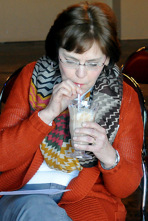Karen Armbruster, Woods County 4-H, devours a PCIC Shake prepared by Camden and Caton Cope from the Watonga 4-H during demonstration competition at 4-H Day at Oakwood Mall Saturday, Jan. 04, 2014. (Staff Photo by BONNIE VCULEK)