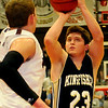Kingfisher's Landon Nault pulls up for two over Pioneer's Colby Koontz during the Yellowjackets' 41-36 win over the Mustangs in the 45th annual Wheat Capital Basketball Tournament at Chisholm High School Friday, Jan. 10, 2014. (Staff Photo by BONNIE VCULEK)