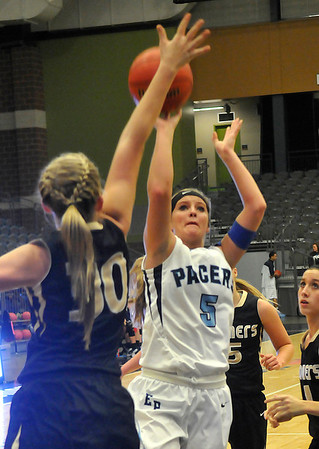 Enid's Haven Bay shoots over Woodward's Lauren Garner Tuesday at the Enid Event Center. (Staff Photo by BILLY HEFTON)