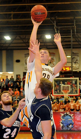 Alva's Lane Madsen scores over Kingfisher's Keaton Ely and Jace Sternberger during the 45th annual Wheat Capital Championship game at the Paul J. Outhier Field House at Chisholm High School Saturday, Jan. 11, 2014. (Staff Photo by BONNIE VCULEK)