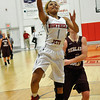 NOC Enid's Kiara Moore lays the ball up against Redlands CC Monday at the NOC Mabee Center. (Staff Photo by BILLY HEFTON)