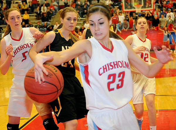 Chisholm's Kammi Gruber (23) keeps the ball in play as the Lady Longhorns score on a put back against the Alva Lady Goldbugs during the 45th annual Wheat Capital Basketball Tournament at Chisholm High School Friday, Jan. 10, 2014. (Staff Photo by BONNIE VCULEK)