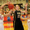 Chisholm's Emily Raynor (left) and Alva's Lora Riley battle for the rebound in the Lady Goldbugs 37-19 win over the Lady Longhorns during the semi-final game in the 45th annual Wheat Capital Basketball Tournament at Chisholm High School Friday, Jan. 10, 2014. (Staff Photo by BONNIE VCULEK)