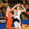 Fairview's Sadie Mason (left) and Alva's Lora Riley collide on an inbound pass during the Lady Jackets 60-55 win over the Lady Goldbugs in the 45th annual Wheat Capital Basketball Tournament at the Paul J. Outhier Field House at Chisholm High School. With the victory, the Lady Jackets won their fifth consecutive Wheat Capital Championship. (Staff Photo by BONNIE VCULEK)