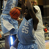 Enid's Raeshaan Finley flies backward between Lawton IKE's Douglas Moore and Keyshawn Perkins before Finley attempts a hoop against the Eagles at the Enid Event Center Saturday, Jan. 18, 2014. (Staff Photo by BONNIE VCULEK)