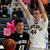 PC-H's Zach Rayner dribble around Drummond's Clayton Wilson during the Panthers' win Friday, Jan. 31, 2014. (Staff Photo by BONNIE VCULEK)