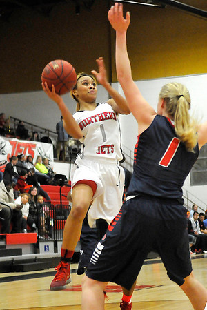 NOC-Enid's Kiara Moore puts up a shot over Seminole State's Whitney Stotler Monday at the NOC Mabee Center. (Staff Photo by BILLY HEFTON)