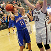 Garber's Elyssa Nagel pressures Kysha Eck of Waukomis Tuesday at the Enid Event Center during the first round of the 90th Skeltur Tournament. (Staff Photo by BILLY HEFTON)
