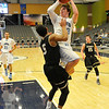 Enid's Braden Rogersr puts up a shot against Woodward's Taylan Iliff Tuesday at the Enid Event Center. (Staff Photo by BILLY HEFTON)
