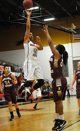 NOC Enid's Tierra Coffey shoots over Redlands'  Wykeena King Monday at the NOC Mabee Center. (Staff Photo by BILLY HEFTON)