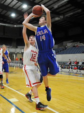 DCLA's Dylan Tefft shoots while defended by Kremlin-Hillsdale's Eli Voth Thursday at the Chisholm Trail Expo Center during the first round of the Cherokee Strip Conference Tournament. (Staff Photo by BILLY HEFTON)