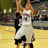 Hunter Lovell of Waukomis puts up a shot while defended by Garber'sGreg Grimes at the Enid Event Center Wednesday during the 90th Skeltur Conference Tournament. (Staff Photo by BILLY HEFTON)