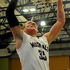 Pioneer's Colby Koontz slams the ball through the hoop as the Mustangs beat the Covington-Douglas Wildcats during the first boys game of the 90th annual Skeltur Conference Basketball Tournament at the Enid Event Center Monday, Jan. 20, 2014. (Staff Photo by BONNIE VCULEK)