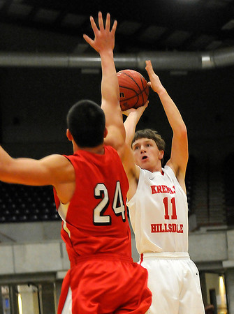 Kremlin-Hillsdale's Kass Bittle shoots over Alex Castro of Cherokee Firday at the Chisholn Trail Expo Center during a semi-final game of the Cherokee Strip Conference Tournament. (Staff Photo by BILLY HEFTON