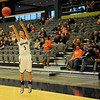 Pioneer's Sage Lamunyon launches a three-point shot and scores for the Mustangs during the 90th annual Skeltur Conference Basketball Tournament at the Enid Event Center Monday, Jan. 20, 2014. (Staff Photo by BONNIE VCULEK)
