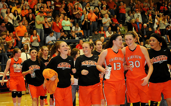 As the fans cheer, the Fairview Lady Jackets celebrate their fifth, consecutive Wheat Capital Championship after beating the Alva Lady Goldbugs 60-55 at Chisholm High School Saturday, Jan. 11, 2014. (Staff Photo by BONNIE VCULEK)