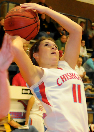 Chisholm's Kaci McCary scores for Lady Longhorns during the Wheat Capital Basketball Tournament at Chisholm High School Friday, Jan. 10, 2014. (Staff Photo by BONNIE VCULEK)