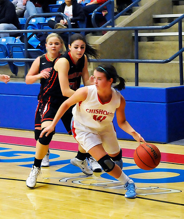 Chisholm's Megan Galusha dribbles away from Morrison defenders Tuesday at Chisholm High School. (Staff Photo by BILLY HEFTON)