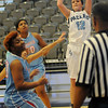 Enid's Savannah Blasi scores for the Pacers as Lawton Eisenhower's Nikki Smith, Kennedi Simien and Crystal Polk defend during the Lady Eagles' 33-32 win at the Enid Event Center Saturday, Jan. 18, 2014. (Staff Photo by BONNIE VCULEK)