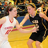 Chisholm's Kaylee Petersen controls the ball against Alva's Lora Riley during the 45th annual Wheat Capital Basketball Tournament at Chisholm High School Friday, Jan. 10, 2014. Alva defeated Chisholm 37-19 to advance into the championship game against the Fairview Lady Jackets Saturday evening. (Staff Photo by BONNIE VCULEK)