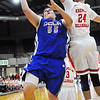 DCLA's Dalton Cunningham gets around Kremlin-Hillsdale's Trev Schoenhals Thursday at the Chisholm Trail Expo Center during the first round of the Cherokee Strip Conference Tournament. (Staff Photo by BILLY HEFTON)