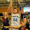 Enid's Grace Enmeier scores as three Ponca City defenders surround her during the Pacers' 52-30 win at the Enid Event Center Friday, Jan. 17, 2014. Enmeier was crowned homecoming queen by king Malik Moses during half time of the Plainsmen's game. (Staff Photo by BONNIE VCULEK)