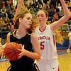 Alva's Nicole Ritter controls the rebound as Chisholm's Nicole Middleton defends during the 45th annual Wheat Capital Basketball Tournament at Chisholm High School Friday, Jan. 10, 2014. Alva won 37-19 and will advance to the championship game against the defending champions, the Fairview Lady Jackets Saturday night. (Staff Photo by BONNIE VCULEK)