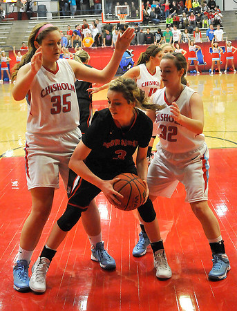 Chisholm's Morgan Broadbent and Asheley Middleton doubleteam Morrison's Jacey Bales Tuesday at Chisholm High School. (Staff Photo by BILLY HEFTON)