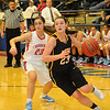 Alva's Jaden Hobbs drives past Chisholm's Kammi Gruber during the Lady Goldbugs semi-final win in the Wheat Capital Basketball Tournament at the Paul J. Outhier Field House at Chisholm High School. Alva will play the Fairview Lady Jackets for the title. (Staff Photo by BONNIE VCULEK)