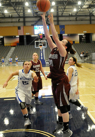 Garber's Shealynn Garrett puts back a rebound against Covington-Douglas Friday at the Enid Event Center during the 3rd place game of the 90th Skeltur Conference Tournament. (Staff Photo by BILLY HEFTON)