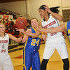 NOC-Enid Lady Jets' Breck Clark watches as her teammate Tierra Coffey grabs a rebound between NEO Lady Golden Norse's McKenzie Solberg (24) and Chanel Akins (50) at the Mabee Center Monday, Jan. 20, 2014. (Staff Photo by BONNIE VCULEK)