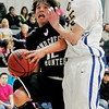 Pond Creek-Hunter's Josh Irvin drives to the hoop against Drummond's Clayton Wilson at Drummond High School Friday, Jan. 31, 2014. (Staff Photo by BONNIE VCULEK)