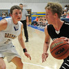 Pond Creek-Hunter's Eric Galliton (right) controls the ball as Drummond's Logan Jantz defends at Drummond High School Friday, Jan. 31, 2014. (Staff Photo by BONNIE VCULEK)