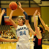 Enid's Grace Enmeier scores for the Pacers as three Ponca City players converge on her during homecoming at the Enid Event Center Friday, Jan. 17, 2014. Enmeier was crowned homecoming queen by king Malik Moses. (Staff Photo by BONNIE VCULEK)