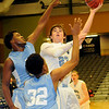 Enid's Braden Rogers takes the ball inside against two Lawton IKE defenders at the Enid Event Center Saturday, Jan. 18, 2014. (Staff Photo by BONNIE VCULEK)