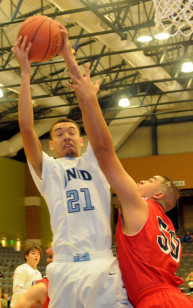Enid's Randy Porter grabs a rebound against Ponca City at the Enid Event Center Friday, Jan. 17, 2014. (Staff Photo by BONNIE VCULEK)