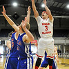 Kremlin-Hillsdale's Andre Lizar shoots over DCLA defenders Thursday at the Chisholm Trail Expo Center during the first round of the Cherokee Strip Conference Tournament. (Staff Photo by BILLY HEFTON)