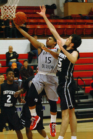 NOC Enid's Cornell Neal puts up a shot against Nikta Peckic of On Point Hoops Monday at the NOC Mabee Center. (Staff Photo by BILLY HEFTON)