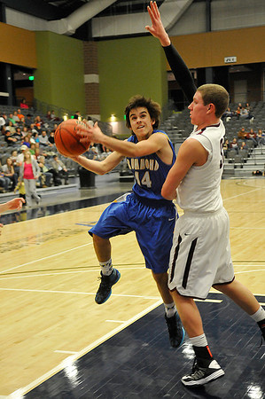 Drummonds Garrett Menendez drives the lane against Pioneer's Colby Koontz Saturday at the Enid Event Center during the finals of the 90th Skeltur Conference Tournament. (Staff Photo by BILLY HEFTON)