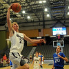 Pioneer's Blake Gabriel sprints toward the bucket for an easy two against the Covington-Douglas Wildcats during the 90th annual Skeltur Conference Basketball Tournament at the Enid Event Center Monday, Jan. 20, 2014. (Staff Photo by BONNIE VCULEK)