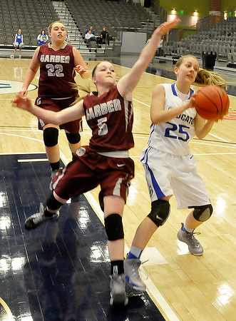 Garber's Kami Oller stops the fast break progress of Kira Wicker of Covington-Douglas Friday at the Enid Event Center during the 3rd place game of the 90th Skeltur Conference Tournament. (Staff Photo by BILLY HEFTON)