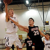 Pioneer's Blake Gabriel collides with Crescent's Tristan Lacey as Gabriel scores during the Mustangs 65-63 overtime win against the Tigers at Pioneer High School Friday, Jan. 03, 2014. (Staff Photo by BONNIE VCULEK)
