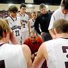 Pioneer Mustangs' head coach, Brandon Gallagher (center) encourages his players during overtime against the Crescent Tigers at Pioneer High School Friday, Jan. 3, 2014. Pioneer won the game 65-63. (Staff Photo by BONNIE VCULEK)