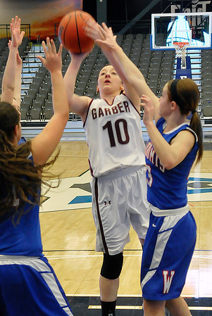Garber's Shealynn Garrett shoots over Mariah Mundell and Savannah Congdon of Waukomis Tuesday at the Enid Event Center during the first round of the 90th Skeltur Tournament. (Staff Photo by BILLY HEFTON)