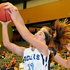 Enid's Abby Lee grabs the offensive board for a put back against Ponca City at the Enid Event Center Friday, Jan. 17, 2014. (Staff Photo by BONNIE VCULEK)